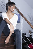 Beutiful black women relaxed at home. Beautiful blck women relaxed sitting in the stairs at home Stock Photography