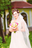 Beutiful bride in white dress holding wedding Stock Photos