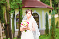 Beutiful bride in white dress holding wedding Royalty Free Stock Images