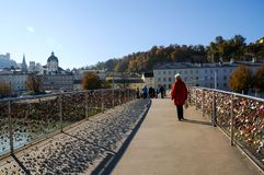 A beutiful Bridge across Salzach river  with view of riverside. Salzach riverside in Salzburg,Austria during atumn Royalty Free Stock Image