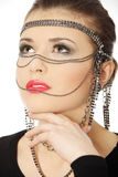Beutiful brunette with jewelery on her face Stock Photography