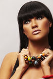 Beutiful brunette with necklace Stock Images