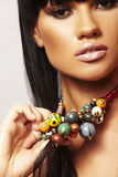 Beutiful brunette with necklace royalty free stock images