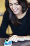 Beutiful brunette using phone Stock Photo