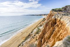 Beutiful cliffs along Falesia Beach in Albufeira, Algarve, Portu. Beutiful cliffs along Falesia Beach and The Atlantic Ocean in Albufeira, Algarve, Portugal Stock Image