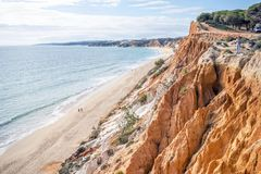 Beutiful cliffs along Falesia Beach in Albufeira, Algarve, Portu. Beutiful cliffs along Falesia Beach and The Atlantic Ocean in Albufeira, Algarve, Portugal Royalty Free Stock Photos