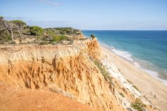 Beutiful cliffs along Falesia Beach in Albufeira, Algarve, Portu. Beutiful cliffs along Falesia Beach and The Atlantic Ocean in Albufeira, Algarve, Portugal Stock Photography