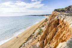 Beutiful cliffs along Falesia Beach in Albufeira, Algarve, Portu. Beutiful cliffs along Falesia Beach and The Atlantic Ocean in Albufeira, Algarve, Portugal Royalty Free Stock Photography