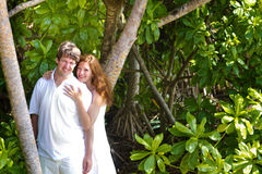 Beutiful couple in a tropical jungle Stock Photos