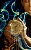Beutiful girl with a clock royalty free stock image