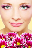 Beutiful girl face with chrysanthemum Royalty Free Stock Images