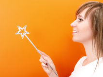 Beutiful and happy fairy with wand Stock Photos