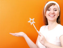 Beutiful and happy fairy with wand Stock Photo
