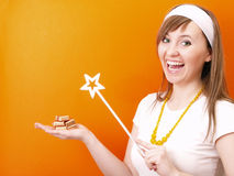 Beutiful and happy fairy with wand Stock Images