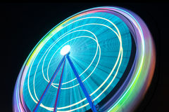 Beutiful Long exposure picture of a ferris wheel rotating, vivid colors. Stock Photography