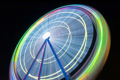 Beutiful Long exposure picture of a ferris wheel rotating, vivid colors. Stock Photos