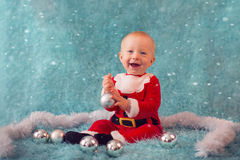 Beautiful smiling little boy in santa costume Royalty Free Stock Image
