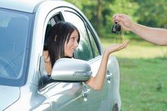 Beutiful teenager. Beautiful teen-ager receiving car keys Royalty Free Stock Images