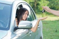 Beutiful teenager. Beautiful teen-ager receiving car keys Stock Photo