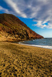 Beutiful View on Empty Sandy Beach with Mountain Stock Images