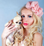 Beautiful woman with small dog in hand smiling Stock Photos