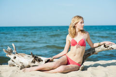 Beutiful young blond woman sunbatching on a beach stock photography