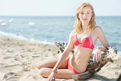 Beutiful young blond woman sunbatching on a beach Stock Photo