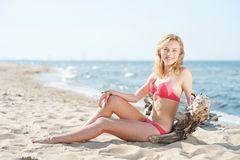 Beutiful young blond woman sunbatching on a beach Royalty Free Stock Images
