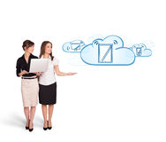 Beutiful young women presenting modern devices in clouds Stock Photo