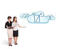 Beutiful young women presenting modern devices in clouds Royalty Free Stock Photos