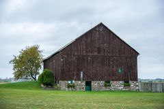 Beutifull Brown Barn. In the rural country side farm Stock Photo