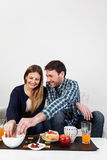 Beutifull couple having a breakfast Royalty Free Stock Images