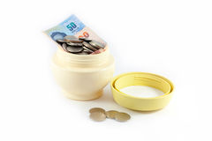 Beuty come from money. Money in the bowl of cosmetic and some on the floor Royalty Free Stock Image