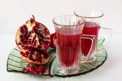 Bevanda del melograno e melograno Immagini Stock