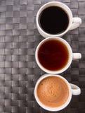 Bevande calde in tazze II Fotografia Stock