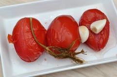 Bevarade mogna tomater Arkivbilder