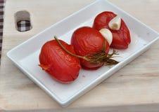 Bevarade mogna tomater Arkivfoto