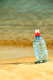 Bevarage. bottle of water drink on a sandy beach. Stock Photo