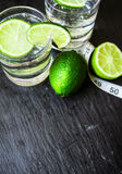 Bevattna med limefrukt Arkivfoto