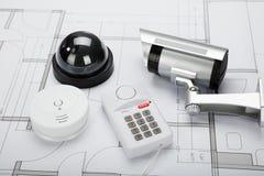 Beveiligingsapparatuur met Blauwdruk Royalty-vrije Stock Afbeeldingen