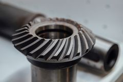 Bevel gear on the shaft, close up view.  royalty free stock photo