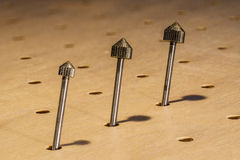 Beveled cutting bit trio Stock Image