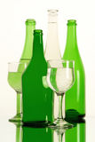 Beverage. Bottles and glasses with a sparkling drink Stock Images
