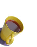 Beverage. In yellow mug on white background. shallow depth of field Stock Photos
