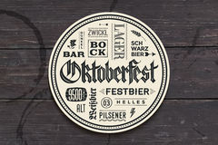 Beverage coaster with lettering for Oktoberfest Beer Festival Royalty Free Stock Photos