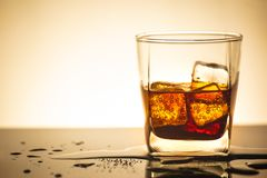 Beverage from cola in glass with ice in studio lighting,beverage in summer is sparkling water. Beverage from cola in glass with ice in studio light,beverage in royalty free stock image