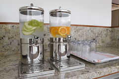 Beverage dispenser with cold water and  fresh fruits. Royalty Free Stock Images