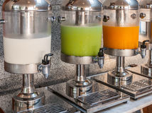 Beverage dispensers. Orange juice, milk and guava juice Royalty Free Stock Photo