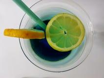 Beverage drink alcohol cocktail bar beverage cocktail mixeddrink whitebackground. Blue lemon glass martiniglass liqueur Stock Photography