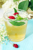 Beverage from elder with strawberries. A cold refreshing summer drink made from elder flowers and strawberries royalty free stock photos